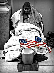 Homeless Man with Two Flags in NYC